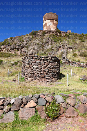 Cut stone Inca period chulpa / burial tower and older rough stone chulpa, Sillustani, Peru