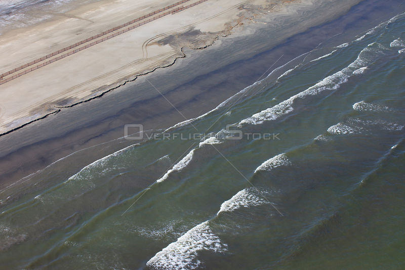 Aerial view of an oil stained beach, contaminated by the BP Deepwater Horizon oil leak in the Gulf of Mexico. Grand Isle, Jefferson Parish, Louisiana, USA, July 2010.