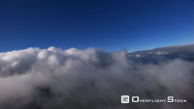 Flying through stratocumulus layer over rugged landscape