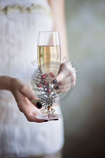 Young woman holding in her hands a glass of champagne