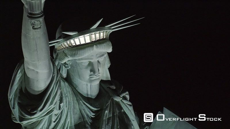 Close flight near Statue of Liberty at night
