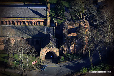 aerial photograph of the ruined North West Tower at the medieval St John the Baptists Church in Chester , Chester , Cheshire England UK.