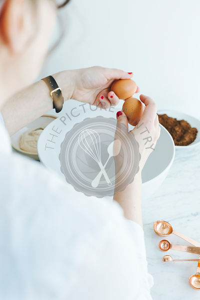 Girl holding eggs whilst cooking