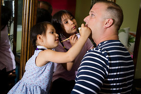 Gaetano Jones, an actor and performer, gets ready with his daughters in Los Angeles