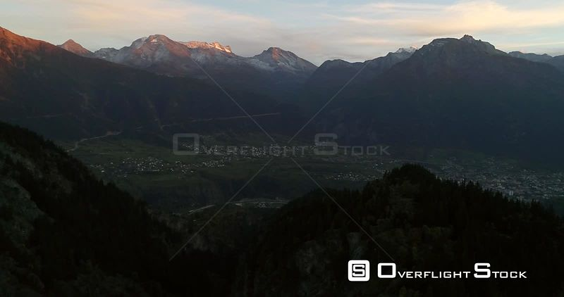 Alpine City, 4k Aerial View, Mountain, Revealing a Town, Sunny Autumn Evening Dawn, Brig and Naters,valais, Alps of Switzerland
