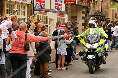 Police Motorcyclist High Fiving Crowd at Olympic Torch Relay