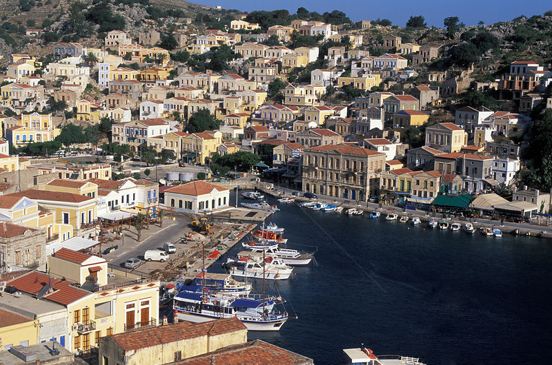 View over a harbour town on the coast of the island of Simi (Symi), Dodecanese Islands, Greece