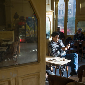 A man smokes in Al Hurriya a cafe bar once popular with Leftist activists, Cairo