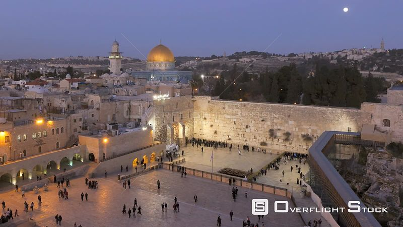 Timelapse from day to night of people praying at the Wailing Wall, with the Dome of the Rock illuminated in the background, Temple Mount, Jerusalem, Israel, 2011.