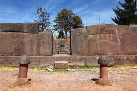 Stone phalluses outside entrance to Inca Uyo fertility temple at Chucuito , near Puno , Peru