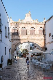 Woman walking in Ostuni (the White town), Apulia, Italy