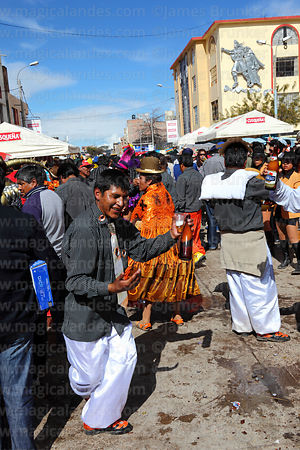 Dancing at street party after formal parades, Virgen de la Candelaria festival, Puno, Peru
