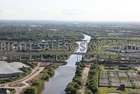 Manchester aerial photograph of the construction of the new bridge crossing the Manchester Ship Canal and Barton high level motorway bridge with the Ship canal locks in the near distance