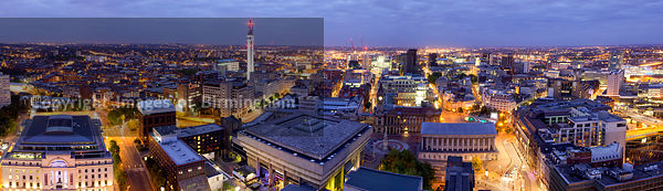 Cityscape panorama of Birmingham at night, England, UK
