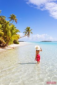 Woman in the turquoise water of One Foot Island, Cook Islands