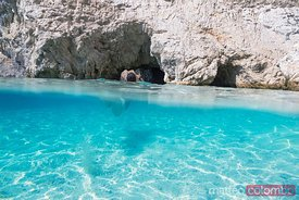 Boy swimming in the famous blue caves in the island of  Zakynthos, Greek Islands, Greece