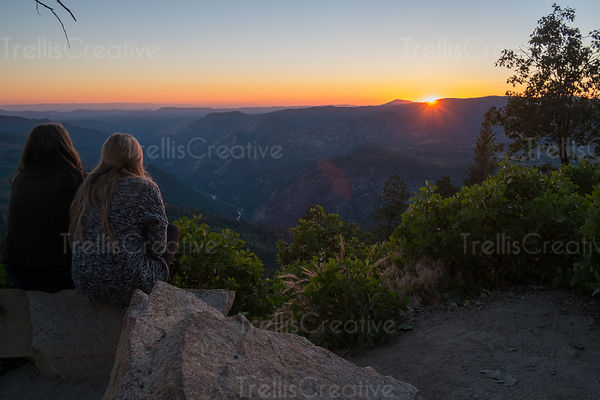 Two teen girls looking at sunset in Yosemite National Park