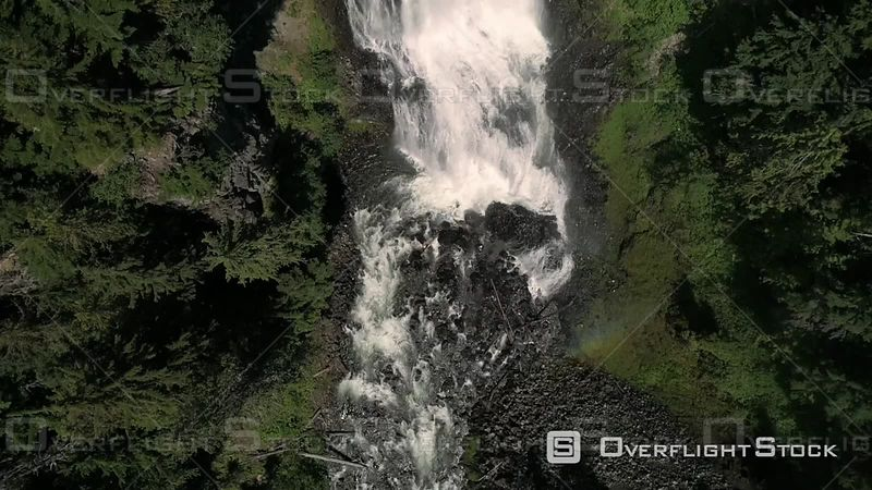 Aerial floating up cascading waterfalls at Alexander Falls by Whistler Canada