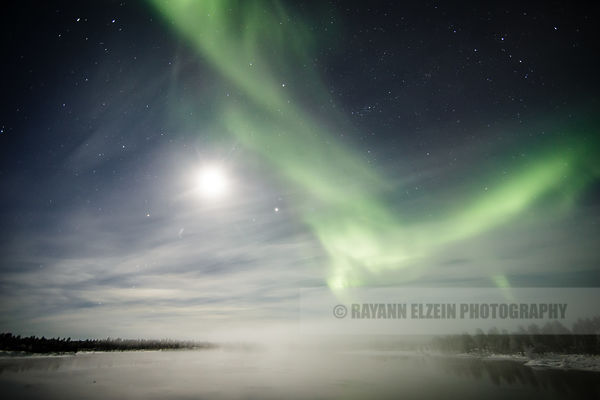 Foggy view with Aurora and full moon