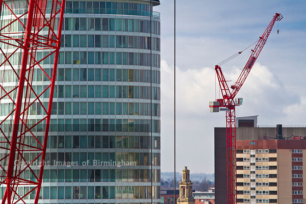 A crane in front of the Rotunda building in Birmingham, West Midlands, England, UK