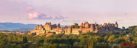 France, Languedoc-Roussillon, Aude, Carcassonne. La cite old fortified town, restored by architect Eugene Viollet le Duc, at sunset