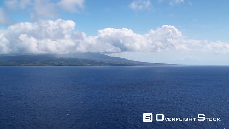 Approaching Maui over blue Pacific.