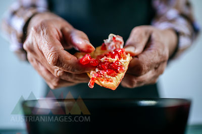 Man's hands peeling a pomegranate, close-up