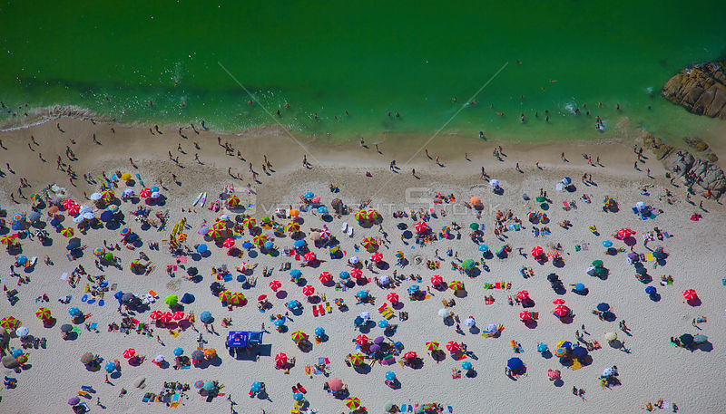 Aerial view of sunbathers on beach, Cape Town, South Africa, December 2009.