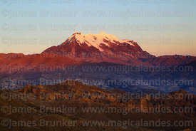 Rock formations above Palca Canyon and Mt Illimani at sunset, Cordillera Real, Bolivia
