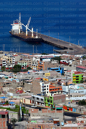 View over the town with Sino West container ship in port of Ilo, Peru
