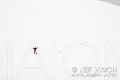 Hiker waving in snow landscape