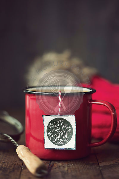 Enamel mug with festive tea bag tag