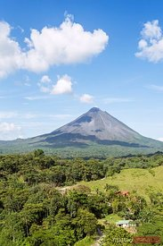 Arenal volcano in a sunny day with blue sky, Alajuela, Costa Rica