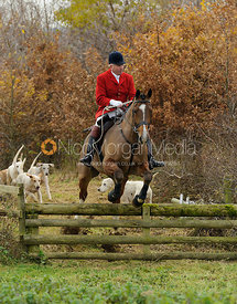 Andrew Osborne MFH jumping a hunt jump - The Cottesmore Hunt at Dene Bank Farm 3-12