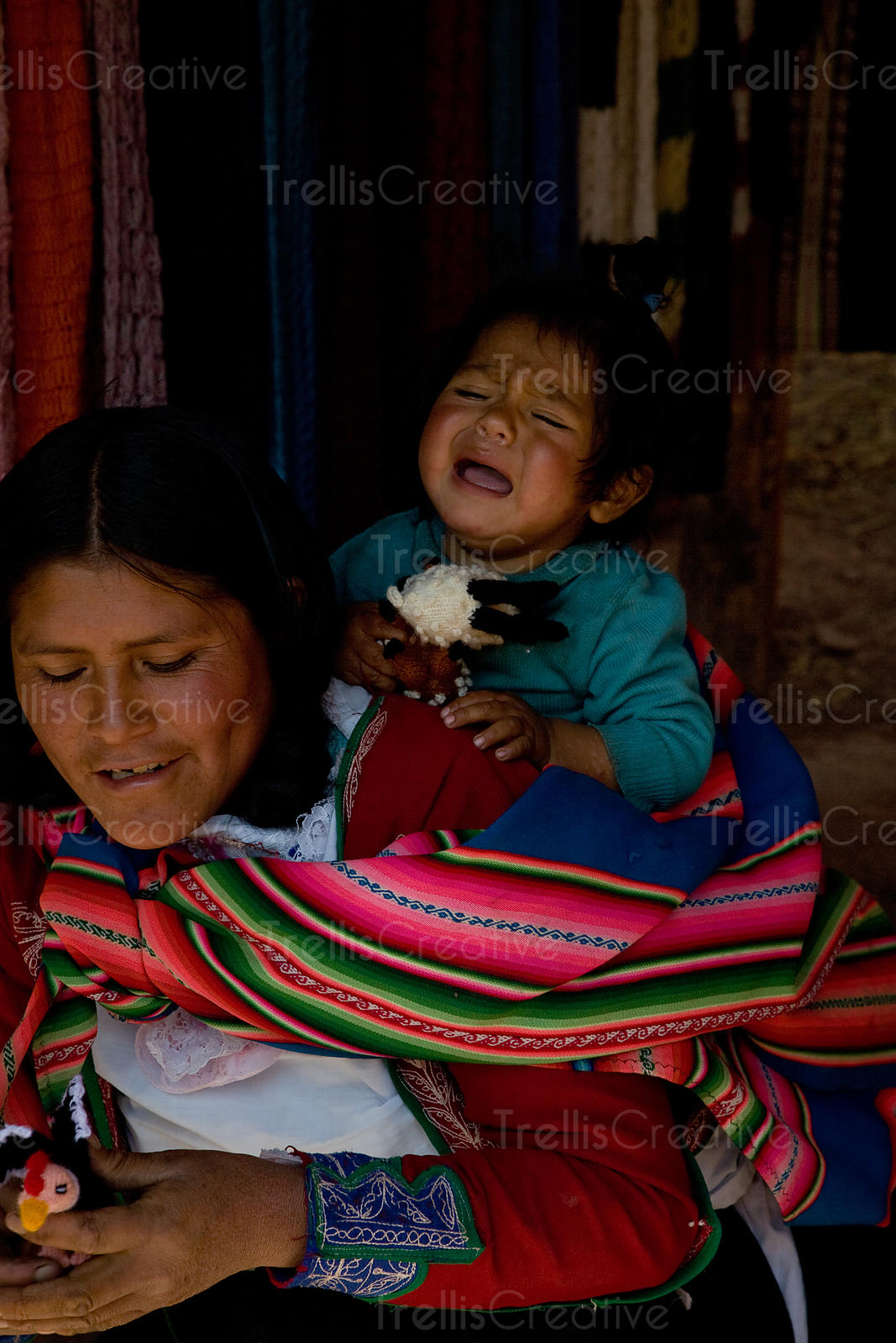 Crying child, Village of Qeshwarani, Peru