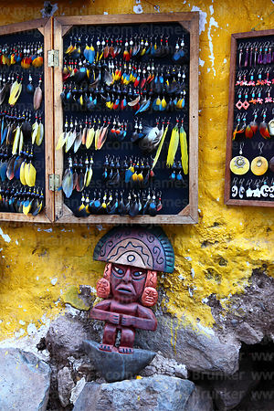 Feather earrings and ceramic tumi for sale at Pisac market, Sacred Valley, Peru