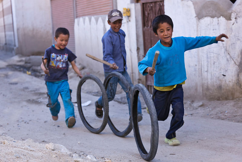Boys Playing with old Bicycle Tyres