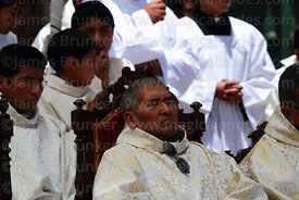Priest having a snooze during central mass for Virgen de la Candelaria festival, Puno, Peru