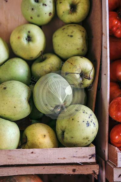 Organic apples in a crate