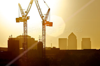 Silhouette Skyline of Cranes and Canary Wharf