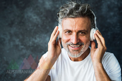 Mature man smiling, wearing headphones