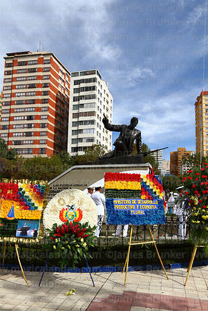 Floral tributes in front of monument to Eduardo Abaroa during Dia del Mar / Day of the Sea, Plaza Avaroa, La Paz, Bolivia
