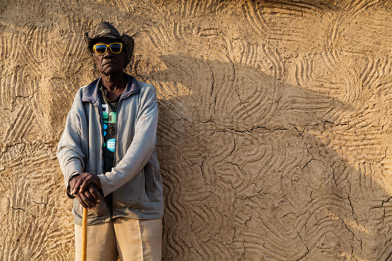 Portrait of a Herero Man against his House