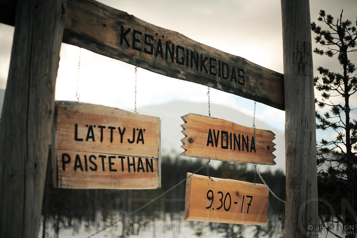 Cafe wooden signs by cross-country ski tracks