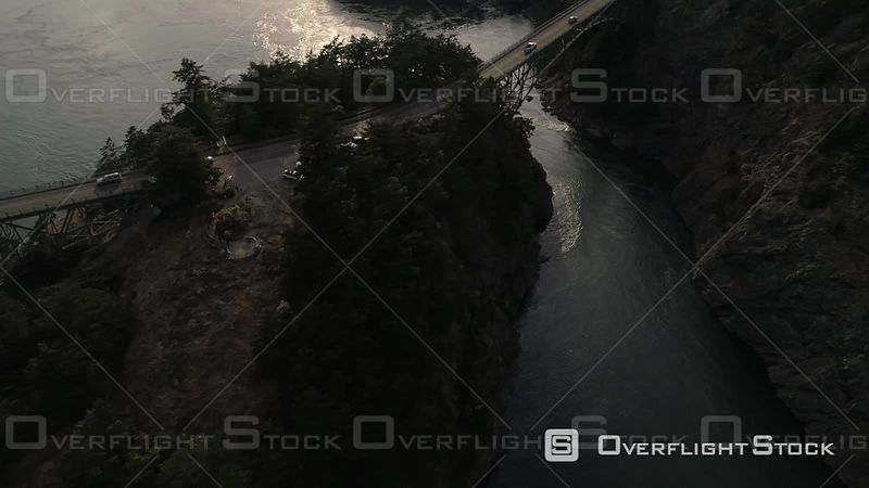 People in cars driving across Puget Sound ocean water on Deception Pass bridge.  Deception Pass Washington USA