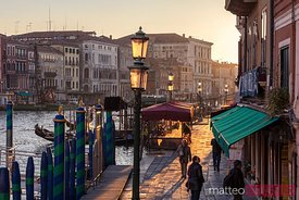 Walkway near Rialto bridge at sunset, Venice, Italy