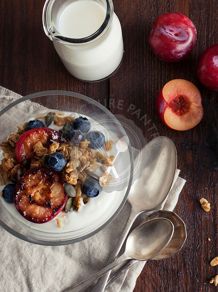Granola served with yoghurt and grilled plums