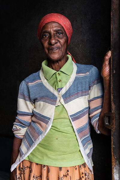 Portrait of a Woman Standing in the Doorway to her Home