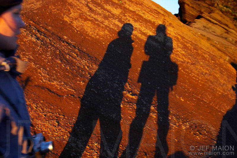 People shadows on rock