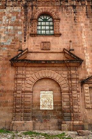 Archway and alabaster tablet on entrance facade of the Temple of Triumph / Templo del Triunfo, Cusco, Peru
